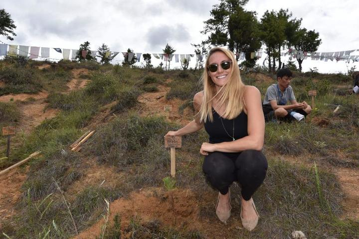 Cassie De Pecol, pictured planting a tree for peace, is the fastest woman to visit every country on earth and the first woman to visit every sovereign nation. (Photo courtesy of Cassie De Pecol)