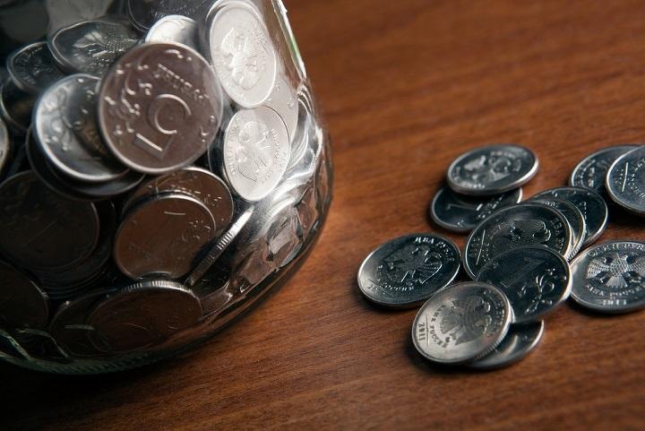 Тенге повысился до328,18 задоллар вконце рабочей недели