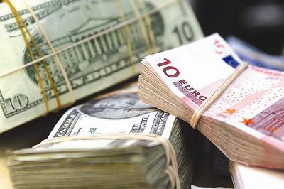 ЕЦБ уменьшает вдвое объемы закупок гособлигаций